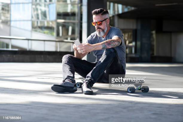 skater - longboard skating stock pictures, royalty-free photos & images