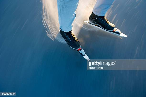 skater preparing to do a stop turn - ice skate stock pictures, royalty-free photos & images