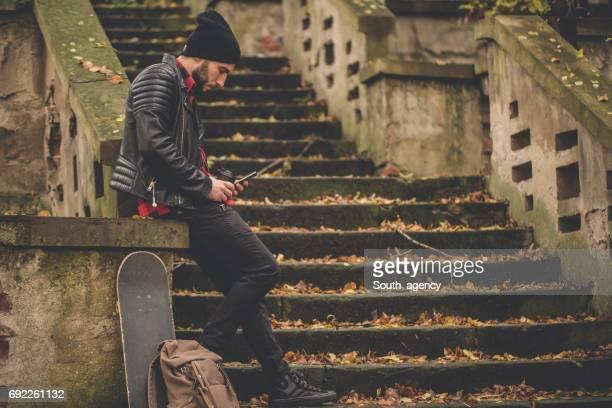 Skater relaxing outdoors