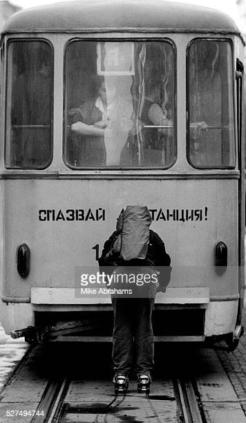 Skater riding a tram through central Sophia Bulgaria April 1989