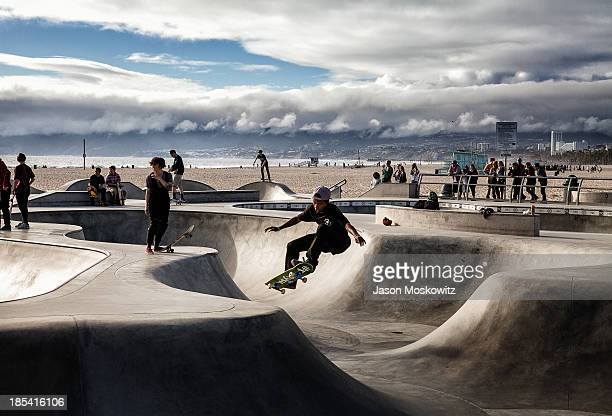 CONTENT] Skater shredding and catching air at the skate park on Venice Beach