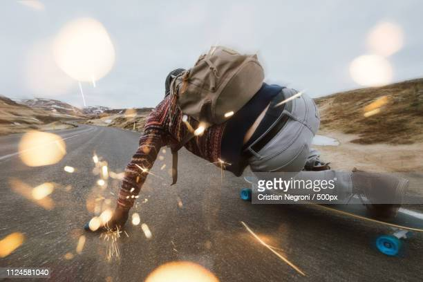skater traveling iceland on his longboard - longboard skating stock pictures, royalty-free photos & images