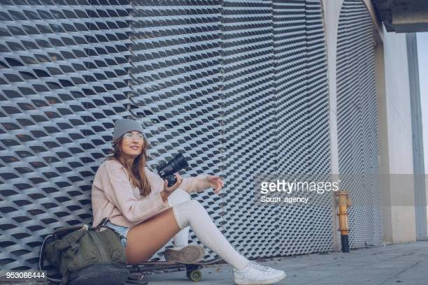 skater woman with digital camera - kneesock stock pictures, royalty-free photos & images