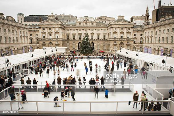 Skaters are pictured on the ice at the Somerset House ice rink in central London on December 1 2013 AFP PHOTO / LEON NEAL