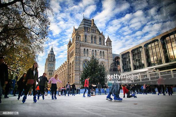 Skaters circle a Christmas tree on the ice at the Natural History Museum ice rink on November 29 2014 in London England Currently 12 seasonal ice...