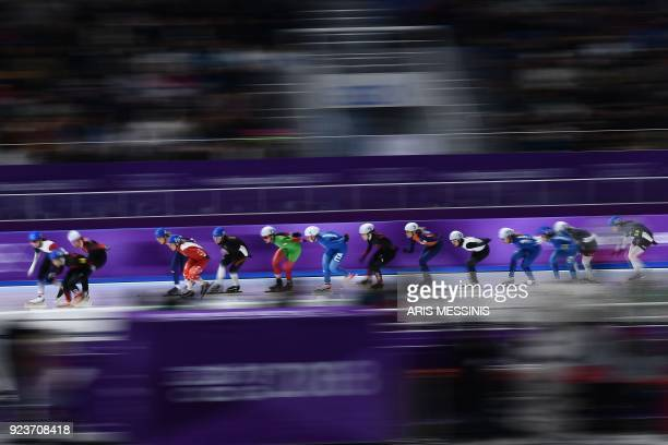 TOPSHOT skaters compete in the men's mass start final speed skating event during the Pyeongchang 2018 Winter Olympic Games at the Gangneung Oval in...