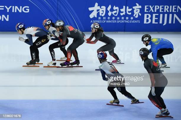 Skaters compete in the mixed team relay quarter finals during the 2021/2022 ISU World Cup short track speed skating, part of a 2022 Beijing Winter...