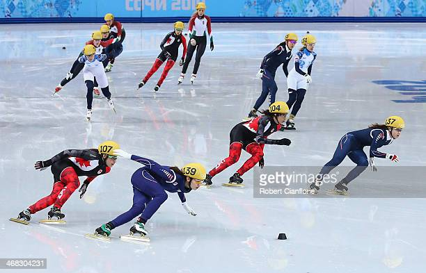 Skaters compete in the Short Track Speed Skating Women's 3000m Relay Semifinal during day three of the Sochi 2014 Winter Olympics at Iceberg Skating...