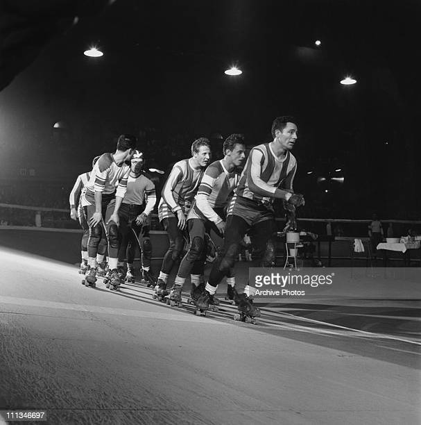 Skaters competing in a roller derby 1950