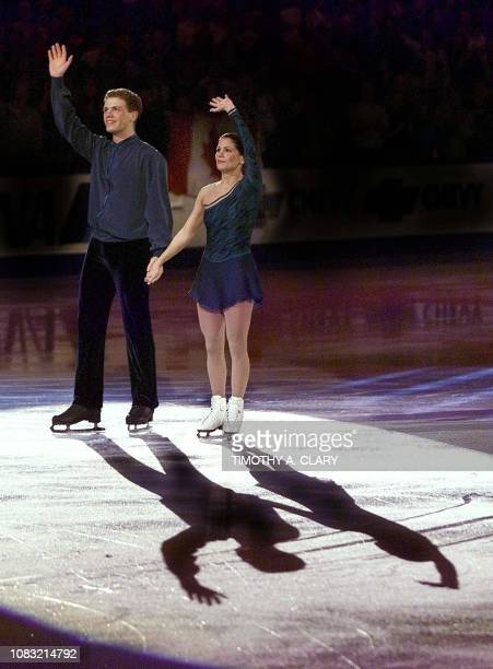 Skaters David Pelletier and partner Jamie Sale of Canada wave to the crowd during the medal ceremonies after the Pairs Free Skate program 21 March...
