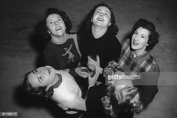 Skaters from the 'Babes in the Wood on Ice' show at the Empress Hall in London perform their twicedaily gargle in an attempt to avoid the 'flu 11th...