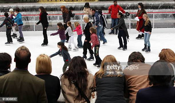 Skaters glide across the Rockefeller Center Skating Rink October 12 2009 in New York City Today was the first day the rink opened for the season a...