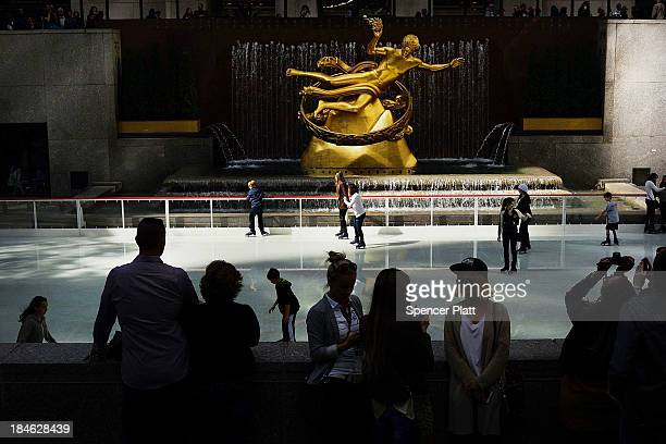 Skaters glide on the ice at the ice rink at Rockefeller Center which opened as part of the plaza's Columbus Day festivities on October 14 2013 in New...