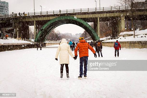 Skaters holding hands on the Rideau Canal