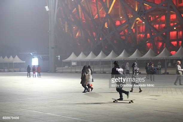 skaters near the bird's nest, beijing. - stadio olimpico nazionale foto e immagini stock