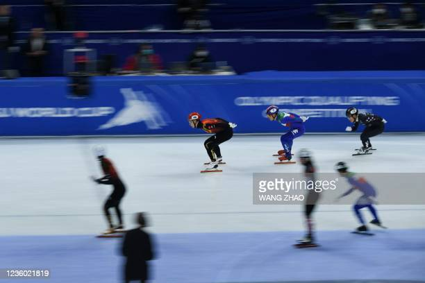 Skaters of China compete in the mixed team relay quarter finals during the 2021/2022 ISU World Cup short track speed skating, part of a 2022 Beijing...