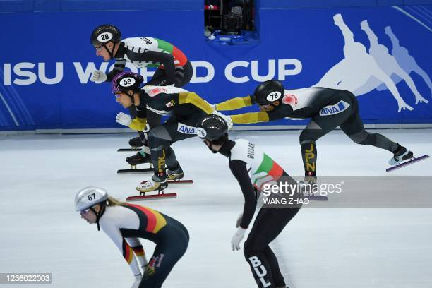 Skaters of Japan compete in the mixed team relay quarter finals during the 2021/2022 ISU World Cup short track speed skating, part of a 2022 Beijing...