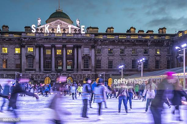 Skaters on ice rink at Somerset House.