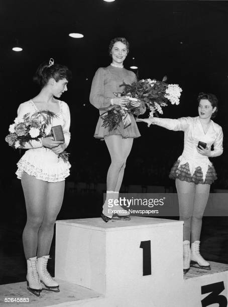 Skaters on the medal podium at the 1958 World Championships Paris France 1958 From left silver medalist Austrian Ingrid Wendl gold medalist American...