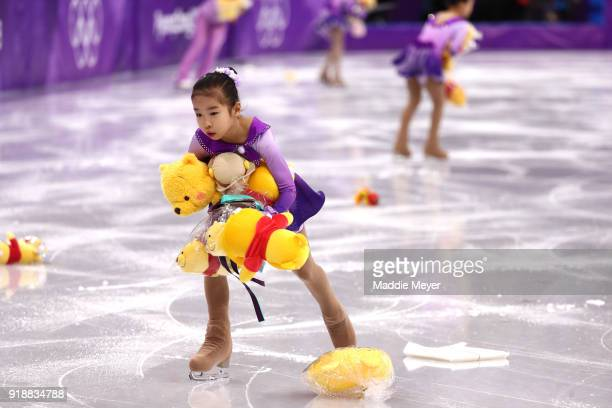 Skaters pick up gifts thrown to the ice for Yuzuru Hanyu of Japan during the Men's Single Skating Short Program at Gangneung Ice Arena on February 16...