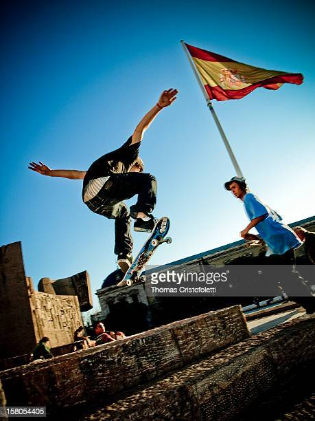 Skaters practicing a trick in the skate park of Plaza Colon, in Madrid .