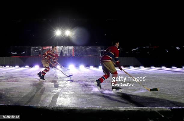 Skaters reenact the first ever NHL game between the Ottawa Senators and Montreal Canadiens during the 2017 Scotiabank NHL100 Classic at Lansdowne...