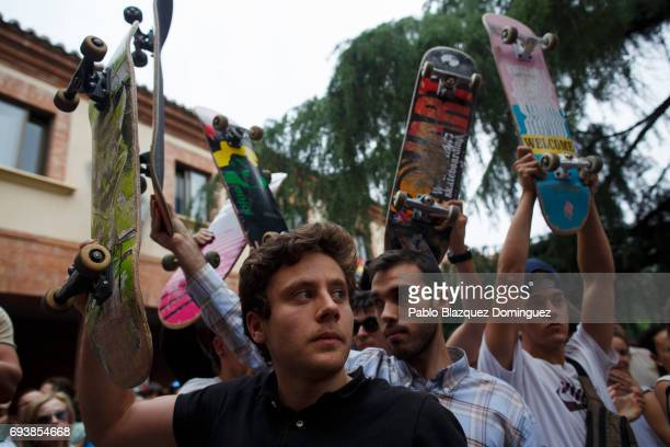 Skaters rise their skateboards during a vigil in tribute to Ignacio Echavarria a victim of the London terror attack outside of Las Rozas City Council...