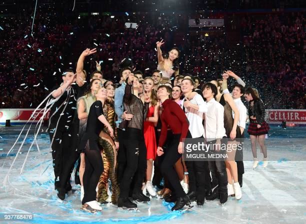 Skaters take a 'selfie' after performing their routines at an Exhibition Gala at The World Figure Skating Championships 2018 in Milan on March 25...