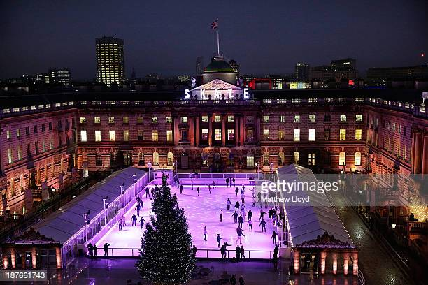 Skaters take to the ice at the Somerset House annual ice skating rink on November 11, 2013 in London, England. Set in Somerset Houses 18th century...