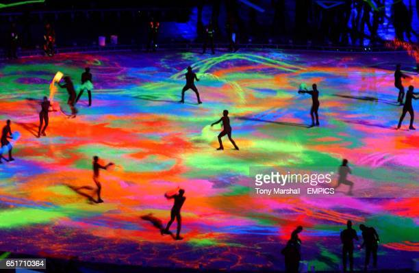 Skaters with buckets and squeeze bottles of ultraviolet paint create a spectaculary glowing multicloloured pallet ala Jackson Pollock