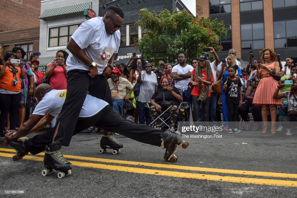 Skaters with Rolloway Productions perform during the 60th anniversary celebration of Ben's Chili Bowl on Wednesday, August 22, 2018, in Washington, DC. This U Street institution, which opened in 1958, has survived the 1968 riots and its neighborhood's rapid gentrification.