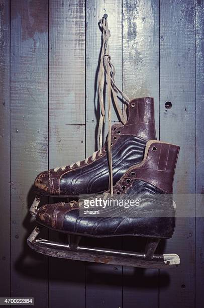 skates hanging on door - ice skate stock pictures, royalty-free photos & images