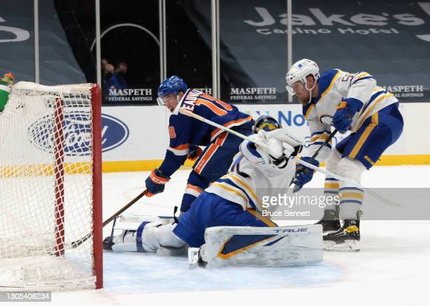Skating in his 300th NHL goal, Anthony Beauvillier s#18 of the New York Islanders cores a second period goal against Jonas Johansson of the Buffalo...