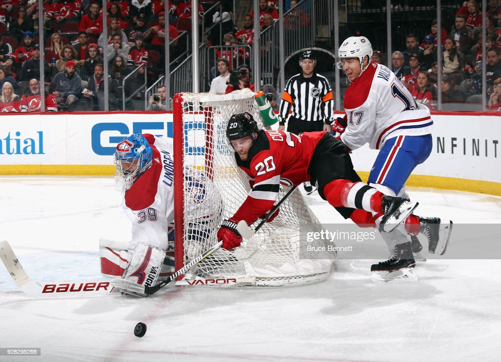 Skating in his first NHL game, Rinat Valiev #17 of the Montreal Canadiens checks Blake Coleman #20 of the New Jersey Devils during the second period at the Prudential Center on March 6, 2018 in Newark, New Jersey.