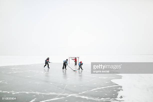 skating on a lake in canada - winter sport stock pictures, royalty-free photos & images