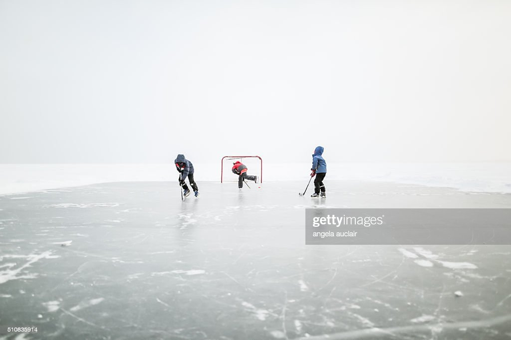 Skating on a lake in Canada : Stock Photo