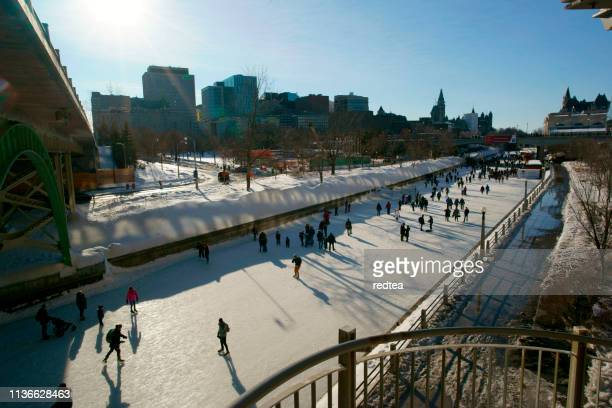 skating on the rideau canal during winterlude in ottawa, canada - ottawa stock pictures, royalty-free photos & images