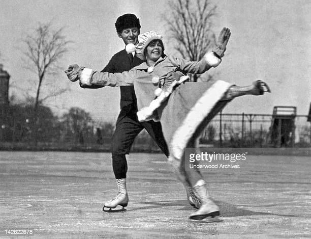 A skating pair show off with some nifty moves on skates Chicago Illinois late 1910s