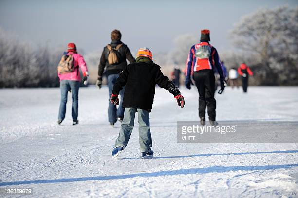 Skating people on a lake in the Netherlands