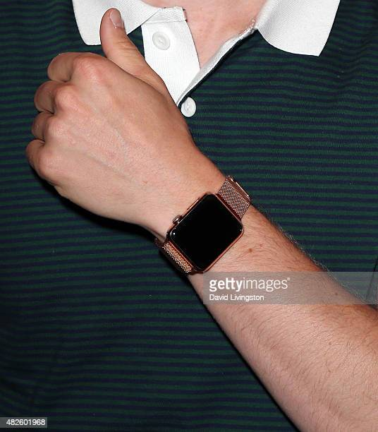 Skee poses with his watch at the FUSE Sunset Cocktail Party at The Beverly Hilton Hotel on July 31 2015 in Beverly Hills California
