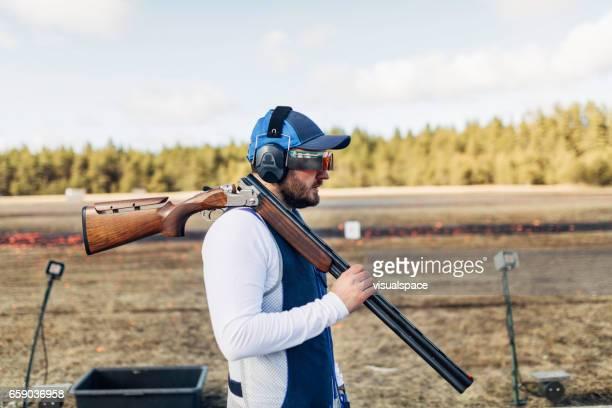 skeet shooter - shotgun stock pictures, royalty-free photos & images