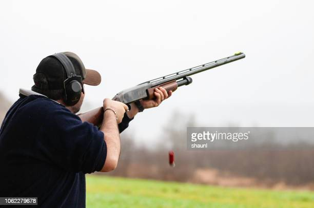 skeet shooting - clay pigeon shooting stock pictures, royalty-free photos & images