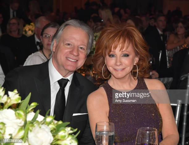 Skeeter Lasuzzo and host Reba McEntire attend Celebrity Fight Night XXV on March 23 2019 in Phoenix Arizona