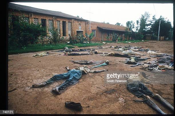 Skeletal remains are strewn on the grounds of the Catholic mission May 5 1994 in Rukara Rwanda Hundreds of Tutsis were killed at the Rukara Catholic...