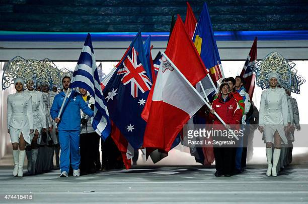 Skeleton athlete Alexandros Kefalas of Greece and skier Elise Pellegrin of Malta lead the flags of the competing nations into the 2014 Sochi Winter...