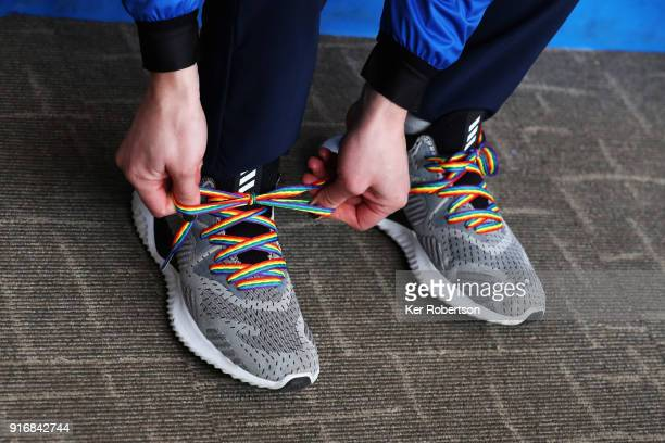 Skeleton athlete Lizzy Yarnold of Great Britain ties a pair of rainbow shoelaces which signify support for LGBT rights while attending a press...