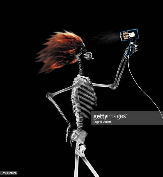 Skeleton blow drying hair