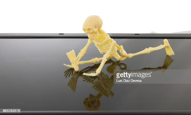 skeleton doing splits in gym on tablet