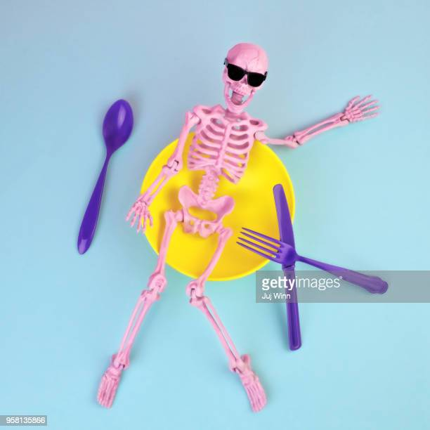 Skeleton in bowl with silverware