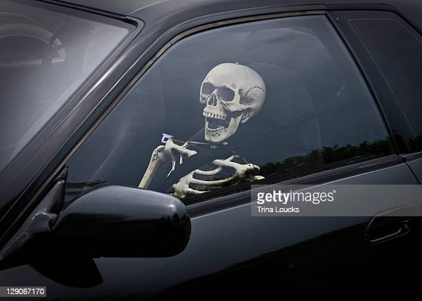 skeleton in front seat of car - funny skeleton stock photos and pictures